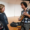 Ally Malecha, 12, left, talks mandolins with Mike Marshall during the lecture-demonstration master class before the benefit concert for the Broomfield High orchestra at the school on Saturday. Malecha also plays the mandolin.<br /> <br /> April 17, 2010<br /> Staff photo/David R. Jennings