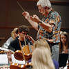 Director Sam Martin leads the Broomfield High Orchestra during rehearsal before the benefit concert with Edgar Meyer and  Mike Marshall at the School on Saturday.<br /> <br /> April 17, 2010<br /> Staff photo/David R. Jennings
