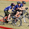 CROSS02<br /> Three racers lead out a hot lap during the Middle Cross Bike Fest at Manhattan Middle School on Wednesday.<br />  <br /> Photo by Marty Caivano/Camera/Nov. 11, 2009
