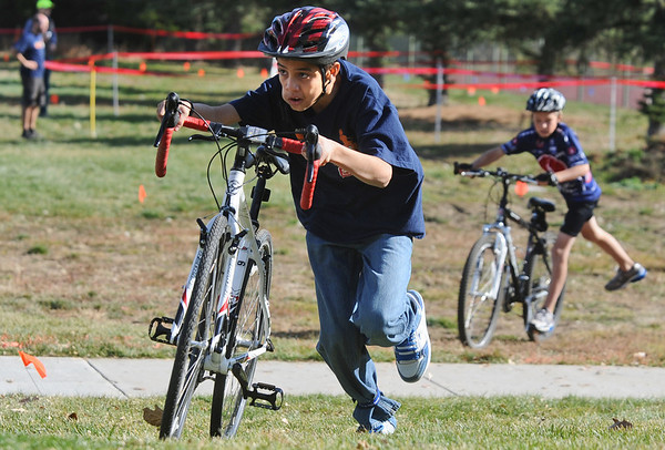 CROSS06<br /> Alejandro Pitones, 12, from Casey Middle School, takes an early lead in his race during the Middle Cross Bike Fest at Manhattan Middle School on Wednesday. He went on to win that heat.<br /> <br />  <br /> Photo by Marty Caivano/Camera/Nov. 11, 2009