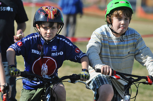 "CROSS04<br /> Jackson Curry, 11, left, and Shane Bunin,12, get their game faces on at the start of their race during the Middle Cross Bike Fest at Manhattan Middle School on Wednesday.<br /> For more photos, visit  <a href=""http://www.dailycamera.com"">http://www.dailycamera.com</a><br /> <br />  <br /> Photo by Marty Caivano/Camera/Nov. 11, 2009"