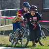 CROSS05<br /> Luis Valtierra, 12, right, beats Calvin Moos, 11, to the top of the run-up during the Middle Cross Bike Fest at Manhattan Middle School on Wednesday.<br /> <br />  <br /> Photo by Marty Caivano/Camera/Nov. 11, 2009