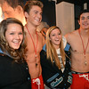 Hollister models Cole Nielsen, second left, and Alex Terranova, right, pose for pictures with Desirae Visser, 16, left, and Chelsea Whiddon, 15, during the Midnight Madness Black Friday event at FlatIron Crossing after midnight on Friday. <br /> November 24, 2012<br /> staff photo/ David R. Jennings