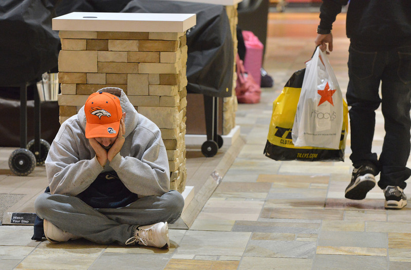 Brian Starling from Henderson, tries to stay awake while waiting for his family to finish shopping during the Midnight Madness Black Friday event at FlatIron Crossing after midnight on Friday. <br /> November 24, 2012<br /> staff photo/ David R. Jennings