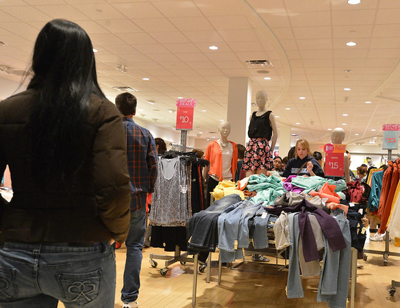 Customers of Charlotte Russe look for bargains during the Midnight Madness Black Friday event at FlatIron Crossing after midnight on Friday.<br /> November 24, 2012<br /> staff photo/ David R. Jennings