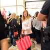 Janis Rossi from Arvada works her way through the crowd after shopping at Victoria's Secrets during the Midnight Madness Black Friday event at FlatIron Crossing after midnight on Friday. <br /> November 24, 2012<br /> staff photo/ David R. Jennings