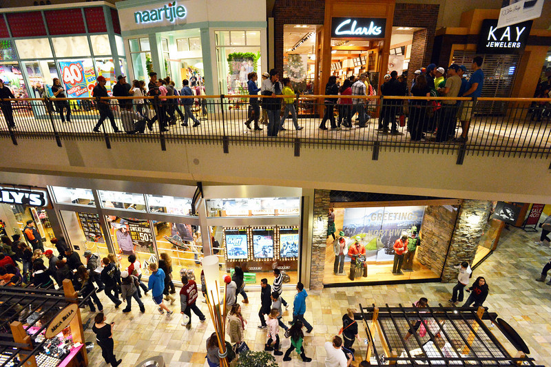 Black Friday customers walk on both levels looking for bargains during the Midnight Madness Black Friday event at FlatIron Crossing after midnight on Friday. <br /> November 24, 2012<br /> staff photo/ David R. Jennings