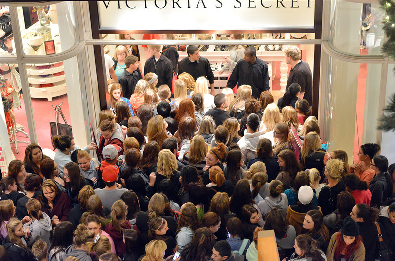 Victoria's Secret customers crowd the entrance of the store  during the Midnight Madness Black Friday event at FlatIron Crossing after midnight on Friday. The store was letting only a few customers in at a time.<br /> November 24, 2012<br /> staff photo/ David R. Jennings