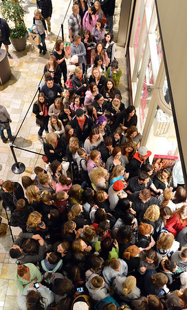 A huge crowd of Black Friday shoppers pack in front of the Victoria's Secret store during the Midnight Madness Black Friday event at FlatIron Crossing after midnight on Friday. The store was letting only a few customers in at a time.<br /> November 24, 2012<br /> staff photo/ David R. Jennings