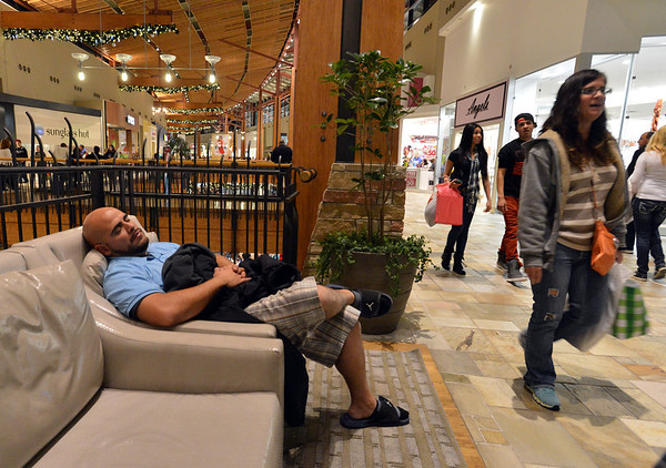 A Black Friday shopper fell asleep in a chair during the Midnight Madness Black Friday event at FlatIron Crossing after midnight on Friday. <br /> November 24, 2012<br /> staff photo/ David R. Jennings