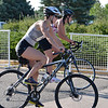 Allison Dutton, left, and Rachel Zierlein begin the bicycle stage of  the Mini Haha Triathlon at the Broomfield Community Center.<br /> June 8, 2012 <br /> staff photo/ David R. Jennings