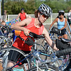 Brooke Kugler puts her bicycle on the rack after finishing the 11 mile bicycle course during the Mini Haha Triathlon at the Broomfield Community Center.<br /> June 8, 2012 <br /> staff photo/ David R. Jennings