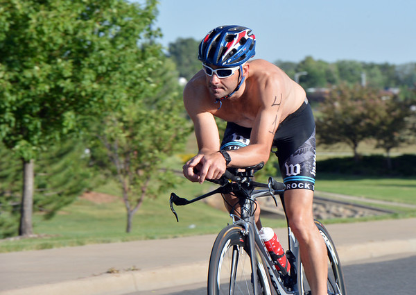 JJ Brandstatter bicycles for the second leg of the Mini Haha Triathlon at the Broomfield Community Center.  Brandstatter was the first to finish the triathlon.<br /> June 8, 2012 <br /> staff photo/ David R. Jennings