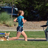 Lisa Walde runs past fans to the finish line of the Mini Haha Triathlon at the Broomfield Community Center.<br /> June 8, 2012 <br /> staff photo/ David R. Jennings