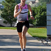 Jennifer Voigt runs up hill on Lamar St.  to the finish line during the Mini Haha Triathlon at the Broomfield Community Center.<br /> June 8, 2012 <br /> staff photo/ David R. Jennings