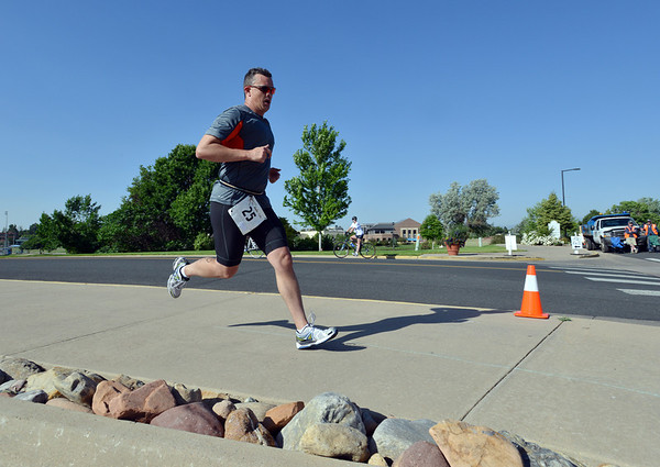 Jerome Blanchette rounds the corner to the finish line of the Mini Haha Triathlon at the Broomfield Community Center.<br /> June 8, 2012 <br /> staff photo/ David R. Jennings