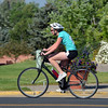 Amy Howard rides her bicycle in the second stage of the Mini Haha Triathlon at the Broomfield Community Center. This was Howard's first triathlon.<br /> June 8, 2012 <br /> staff photo/ David R. Jennings