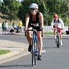 Cody Tiner rides her bicycle in the second stage of the fourth heat   during the Mini Haha Triathlon at the Broomfield Community Center.<br /> June 8, 2012 <br /> staff photo/ David R. Jennings