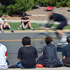 Fans watche the bicyclists ride by on Lamar St.  during the Mini Haha Triathlon at the Broomfield Community Center.<br /> June 8, 2012 <br /> staff photo/ David R. Jennings