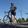 Jamie Wallace runs with his bicycle to begin the second stage of  the Mini Haha Triathlon at the Broomfield Community Center.<br /> June 8, 2012 <br /> staff photo/ David R. Jennings