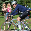 Debbie Wheeler and her daughter Sophia, 4, wave her husband, Simon Wheeler,  as he rides his bicycle during the Mini Haha Triathlon at the Broomfield Community Center.<br /> June 8, 2012 <br /> staff photo/ David R. Jennings