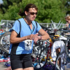 Randi Mitchem checks her watch in the transition area as she begins the third stage of the Mini Haha Triathlon at the Broomfield Community Center.<br /> June 8, 2012 <br /> staff photo/ David R. Jennings