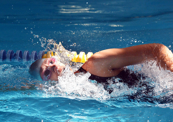 Nikki Moran swims in the final heat of the Mini Haha Triathlon at the Broomfield Community Center. The trathlon had 495 participants this year.<br /> June 8, 2012 <br /> staff photo/ David R. Jennings