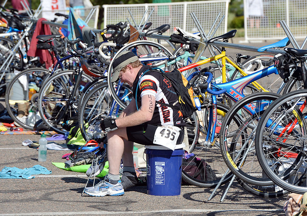 Edward Tugya puts on his shoes in preparation for the next stage af the Mini Haha Triathlon at the Broomfield Community Center.<br /> June 8, 2012 <br /> staff photo/ David R. Jennings