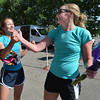 Lisa Walde, left, and Amy Howard congratulate each other after finishing the Mini Haha Triathlon at the Broomfield Community Center.<br /> June 8, 2012 <br /> staff photo/ David R. Jennings