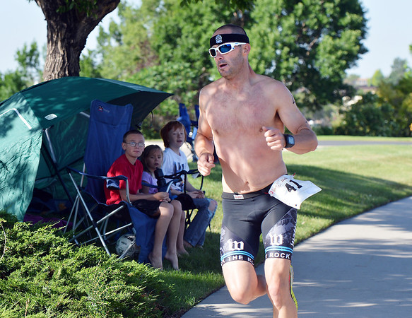 JJ Brandstatter runs to The Bay Aquatic Center as the first to cross the finish for the Mini Haha Triathlon at the Broomfield Community Center.  Brandstatter was the first to finish the triathlon.<br /> June 8, 2012 <br /> staff photo/ David R. Jennings