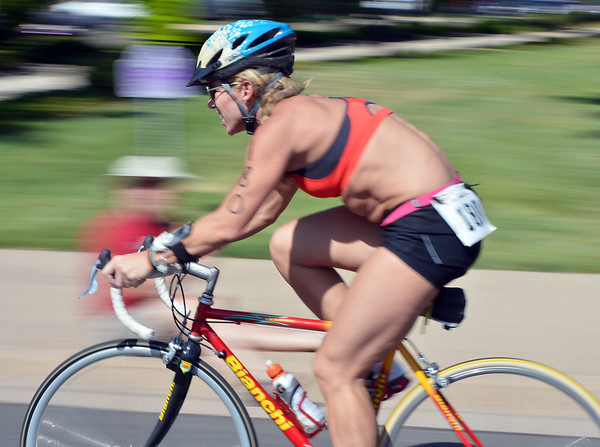 Denise Jones rides her bicycle during the Mini Haha Triathlon at the Broomfield Community Center.<br /> June 8, 2012 <br /> staff photo/ David R. Jennings