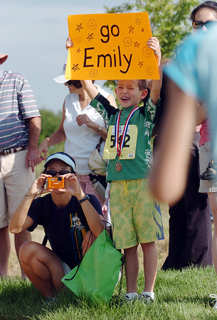 Fans cheer for a competitor during the first MiniMini  HaHa for Kids triathlon at the Broomfield Community Center on Sunday.<br /> <br /> August 14, 2011<br /> staff photo/ David R. Jennings