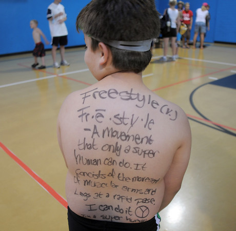 Michael Barella, 8, has an inspirational message written on his back for the first MiniMini  HaHa for Kids triathlon at the Broomfield Community Center on Sunday.<br /> <br /> August 14, 2011<br /> staff photo/ David R. Jennings