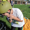 Michael Barella, 8, straps on his helmet for the bicycling portion of  the first MiniMini  HaHa for Kids triathlon at the Broomfield Community Center on Sunday.<br /> <br /> August 14, 2011<br /> staff photo/ David R. Jennings