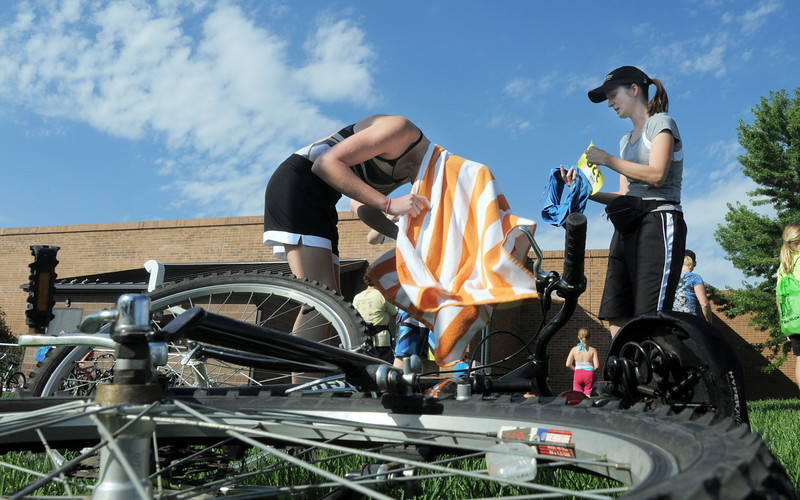 Madelaine McClain, 13, dries her hair while preparing for the bicycle portion with the help of her mother, Amy, during the first MiniMini  HaHa for Kids triathlon at the Broomfield Community Center on Sunday.<br /> <br /> August 14, 2011<br /> staff photo/ David R. Jennings