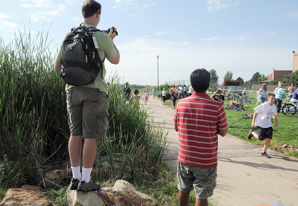 Fans take pictures of the competitors during the first MiniMini  HaHa for Kids triathlon at the Broomfield Community Center on Sunday.<br /> <br /> August 14, 2011<br /> staff photo/ David R. Jennings