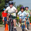Max Cunningham, 8, rides his bicycle during the first MiniMini  HaHa for Kids triathlon at the Broomfield Community Center on Sunday.<br /> <br /> August 14, 2011<br /> staff photo/ David R. Jennings