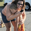 Kyle White, 6, gets a hug from his mother, Dina, at the finish line of the first MiniMini  HaHa for Kids triathlon at the Broomfield Community Center on Sunday.<br /> <br /> August 14, 2011<br /> staff photo/ David R. Jennings