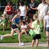 Madelaine McClain, 13, begins the running portion during the first MiniMini  HaHa for Kids triathlon at the Broomfield Community Center on Sunday.<br /> <br /> August 14, 2011<br /> staff photo/ David R. Jennings