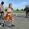 Kyle White, 6, crosses the finish line during the first MiniMini  HaHa for Kids triathlon at the Broomfield Community Center on Sunday.<br /> <br /> August 14, 2011<br /> staff photo/ David R. Jennings