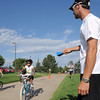J.J. Brandstatter rings a cowbell to cheer on competitors during the first MiniMini  HaHa for Kids triathlon at the Broomfield Community Center on Sunday.<br /> <br /> August 14, 2011<br /> staff photo/ David R. Jennings