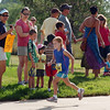 A participant runs past spectators during the first MiniMini  HaHa for Kids triathlon at the Broomfield Community Center on Sunday.<br /> <br /> August 14, 2011<br /> staff photo/ David R. Jennings