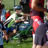Matthew Poshusta, 7, runs with his bicycle to the transition area to begin the run portion during the first MiniMini  HaHa for Kids triathlon at the Broomfield Community Center on Sunday.<br /> <br /> August 14, 2011<br /> staff photo/ David R. Jennings