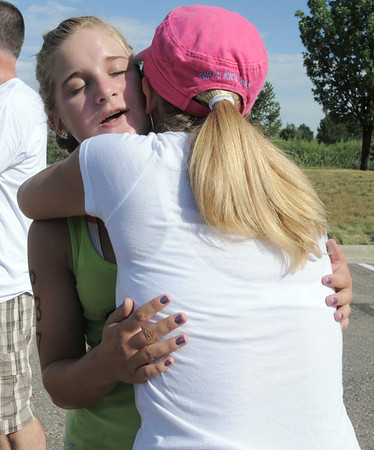 Madison Mueller, 13, hugs her mother Veronica after finishing the first MiniMini  HaHa for Kids triathlon at the Broomfield Community Center on Sunday.<br /> <br /> August 14, 2011<br /> staff photo/ David R. Jennings