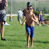 Dylan Barrett, 7, runs to his bicycle in the transition area after completing the swimming leg during the first MiniMini  HaHa for Kids triathlon at the Broomfield Community Center on Sunday.<br /> <br /> August 14, 2011<br /> staff photo/ David R. Jennings