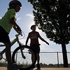 A competitor walks to the bycycle portion starting line during the first MiniMini  HaHa for Kids triathlon at the Broomfield Community Center on Sunday.<br /> <br /> August 14, 2011<br /> staff photo/ David R. Jennings
