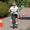 Michale Barella, 8, coasts to the transition area during the first MiniMini  HaHa for Kids triathlon at the Broomfield Community Center on Sunday.<br /> <br /> August 14, 2011<br /> staff photo/ David R. Jennings