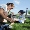 Kira Barrett, left, helps her son Dyaln with his shoes before riding his bicycle during the first MiniMini  HaHa for Kids triathlon at the Broomfield Community Center on Sunday.<br /> <br /> August 14, 2011<br /> staff photo/ David R. Jennings
