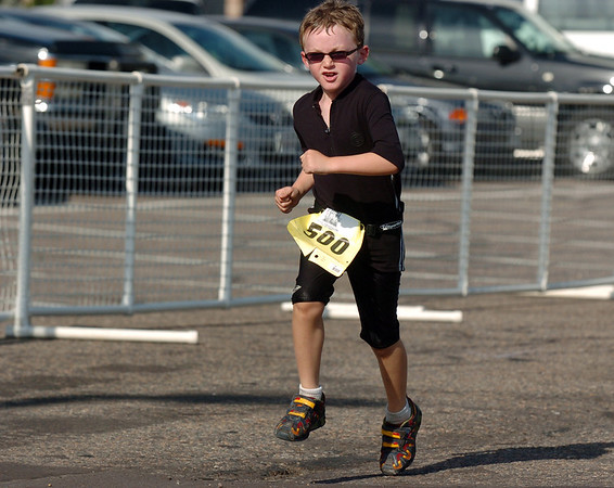 Blaine Krug, 7, makes the final push to finish the first MiniMini  HaHa for Kids triathlon at the Broomfield Community Center on Sunday.<br /> <br /> August 14, 2011<br /> staff photo/ David R. Jennings