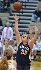 Legacy's Courtney Smith rebounds the ball against Monarch during Friday's game at Monarch High. February 15, 2013 staff photo/ David R. Jennings